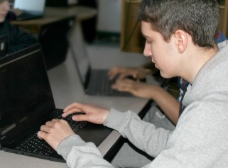 Students in Game Arts & Computer Science Pathway works on Python coding project.